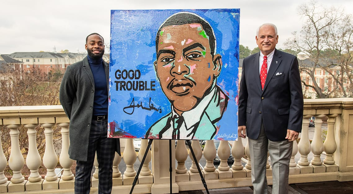 Willie Austin II, a software engineer and 2017 TROY graduate, recently donated a hand-painted portrait of Rep. John Lewis to his alma mater.