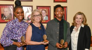 From, left to right, are Sullivan Award winners Oshea Beckford, Martavious Ginyard and Annie Percy with Mrs. Janice Hawkins, First Lady of TROY..