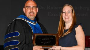 Tucker receives Dr. Robert Kruckeberg Faculty Excellence Award at Troy University