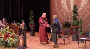 Dr. John Schmidt delivered the keynote address at TROY's Dothan Campus Commencement on Sunday.