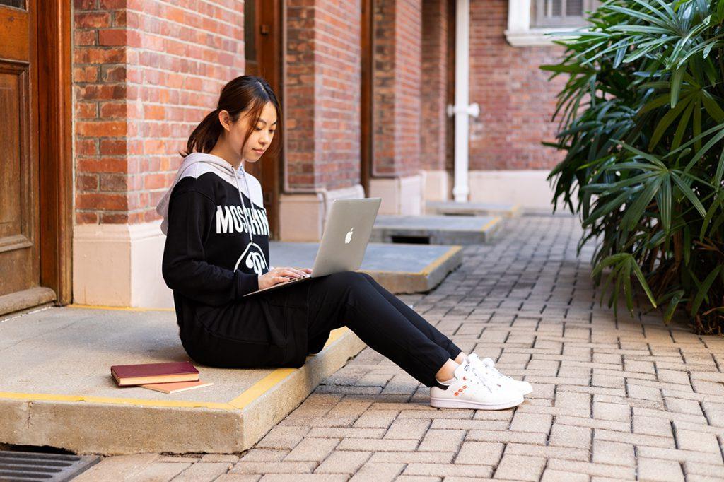 Yitong Wu studies on a computer