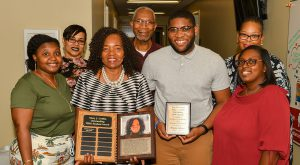 Deonte Jackson received the Mary J. Griffin Most Outstanding TRIO Student Award surrounded by members of TROY's TRIO staff.