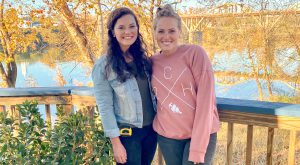 """Alumni Josie Russell Young, left, and Mina Starsiak, host of HGTV's series """"Good Bones,"""" take time during"""