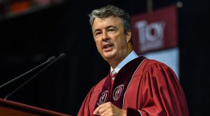 Alabama Attorney General Steve Marshall addresses graduates during Friday morning's summer commencement ceremony at Trojan Arena.