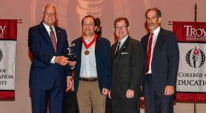 Pictured left to right are: Dr. Jack Hawkins, Jr., Chancellor; Dr. Belyi; Dr. Lance Tatum; and, Dr. Ed Pappanastos, 2020 Malone Award winner.